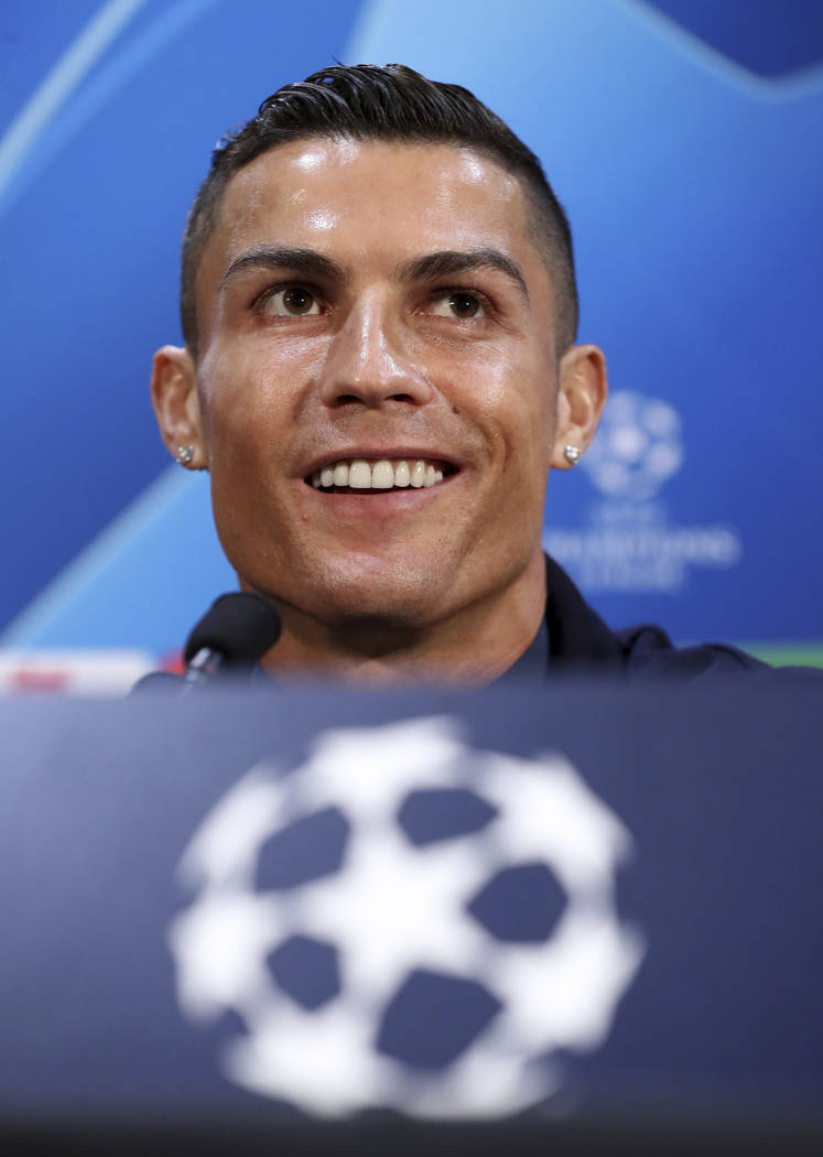 Juventus' Cristiano Ronaldo attends a press conference at Old Trafford, Manchester, England, Monday, Oct. 22, 2018. Juventus will play a Champions League soccer match against Manchester United on ...