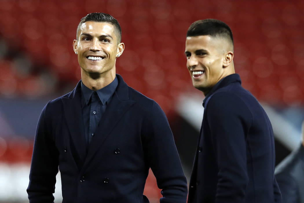 Juventus' Cristiano Ronaldo, left, during the walkaround at Old Trafford, Manchester, England, Monday, Oct. 22, 2018. Juventus will play a Champions League soccer match against Manchester United o ...