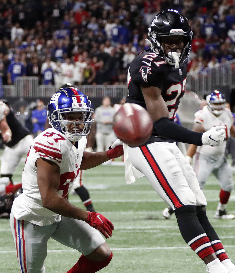 Atlanta Falcons strong safety Damontae Kazee (27) defends against New York Giants wide receiver Sterling Shepard (87) during the second half of an NFL football game, Monday, Oct. 22, 2018, in Atla ...