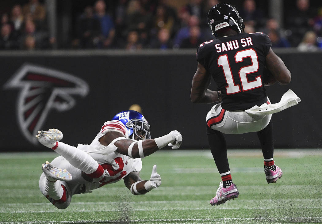 New York Giants strong safety Landon Collins (21) trips up Atlanta Falcons wide receiver Mohamed Sanu (12) during the second half of an NFL football game, Monday, Oct. 22, 2018, in Atlanta. (AP Ph ...