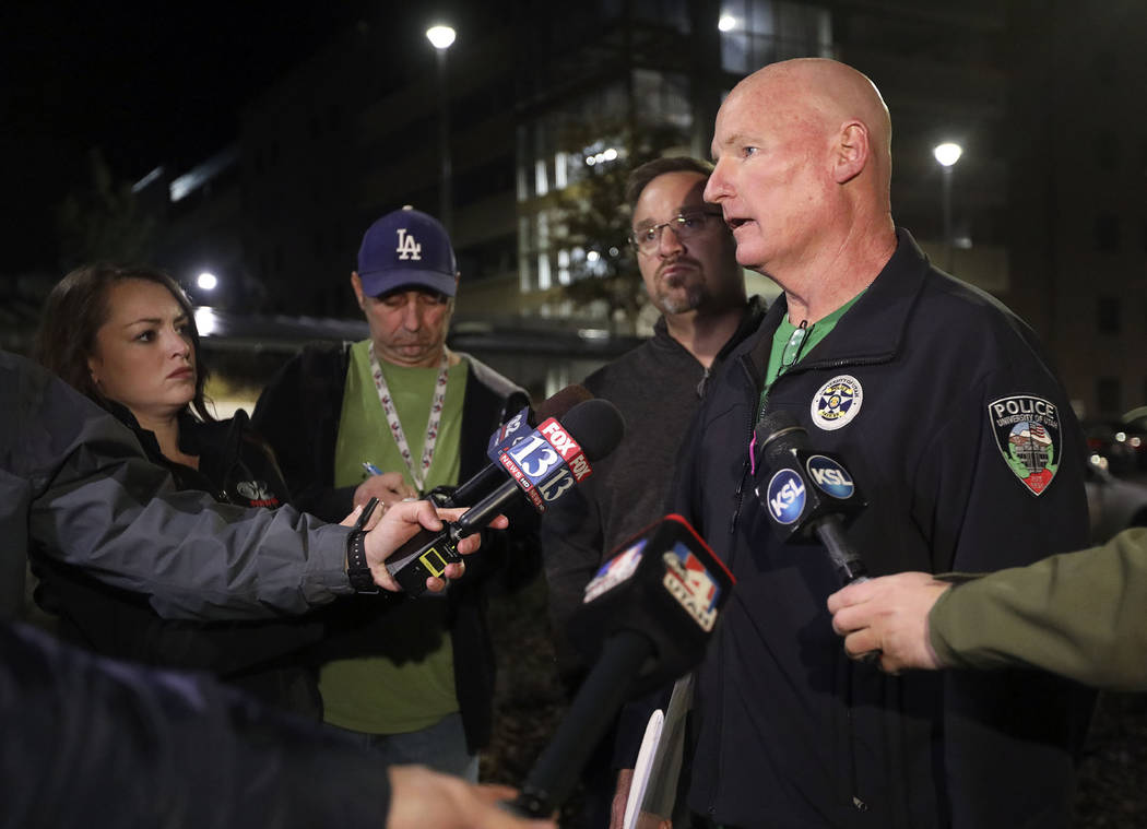 University of Utah Police Lt. Brian Wahlin talks to members of the media outside of the South Medical Tower on the University of Utah campus during a search for a man they say shot and killed a Un ...