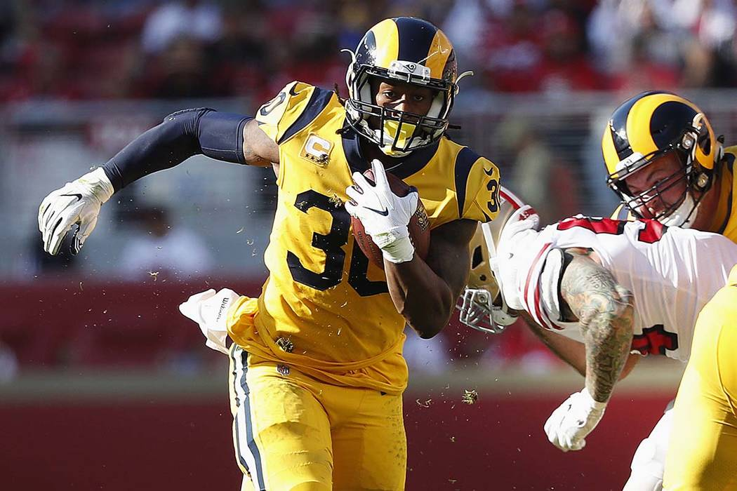 Los Angeles Rams running back Todd Gurley II (30) runs against the San Francisco 49ers during the second half of an NFL football game in Santa Clara, Calif., Sunday, Oct. 21, 2018. (AP Photo/Tony ...