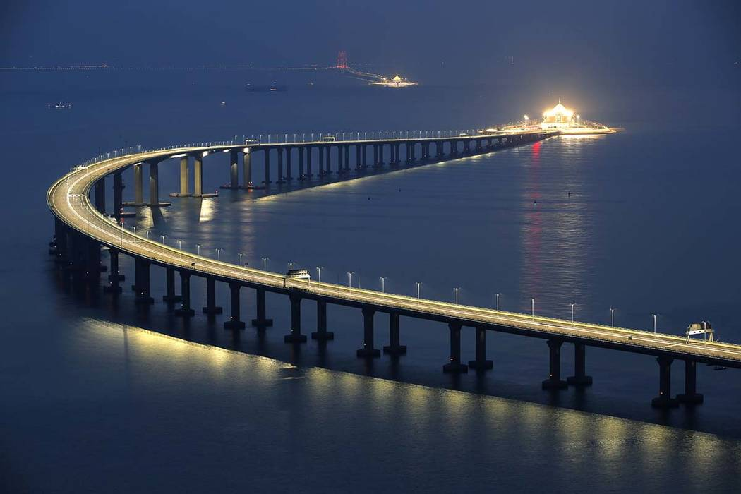 The Hong Kong-Zhuhai-Macau Bridge is lit up in Hong Kong, Monday, Oct. 22, 2018. The bridge, the world's longest cross-sea project, which has a total length of 55 kilometers (34 miles), will have ...