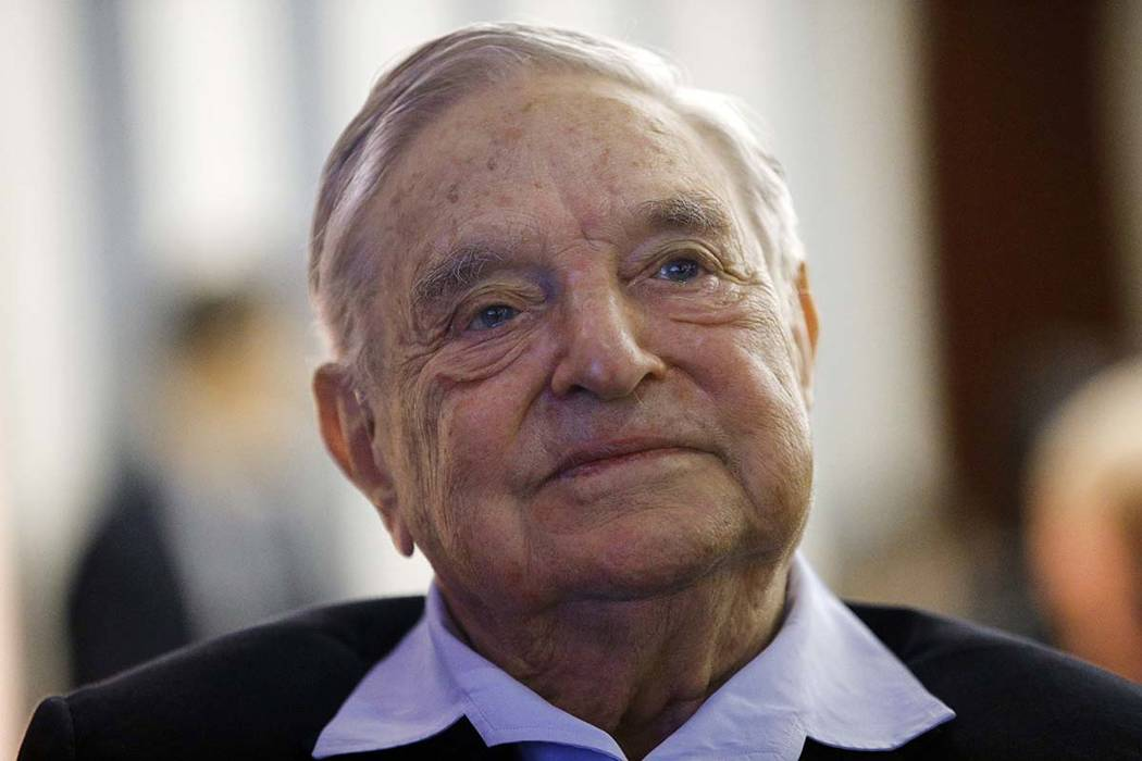 In this May 29, 2018, file photo, philanthropist George Soros, founder and chairman of the Open Society Foundations, attends the European Council On Foreign Relations Annual Meeting in Paris. (AP ...