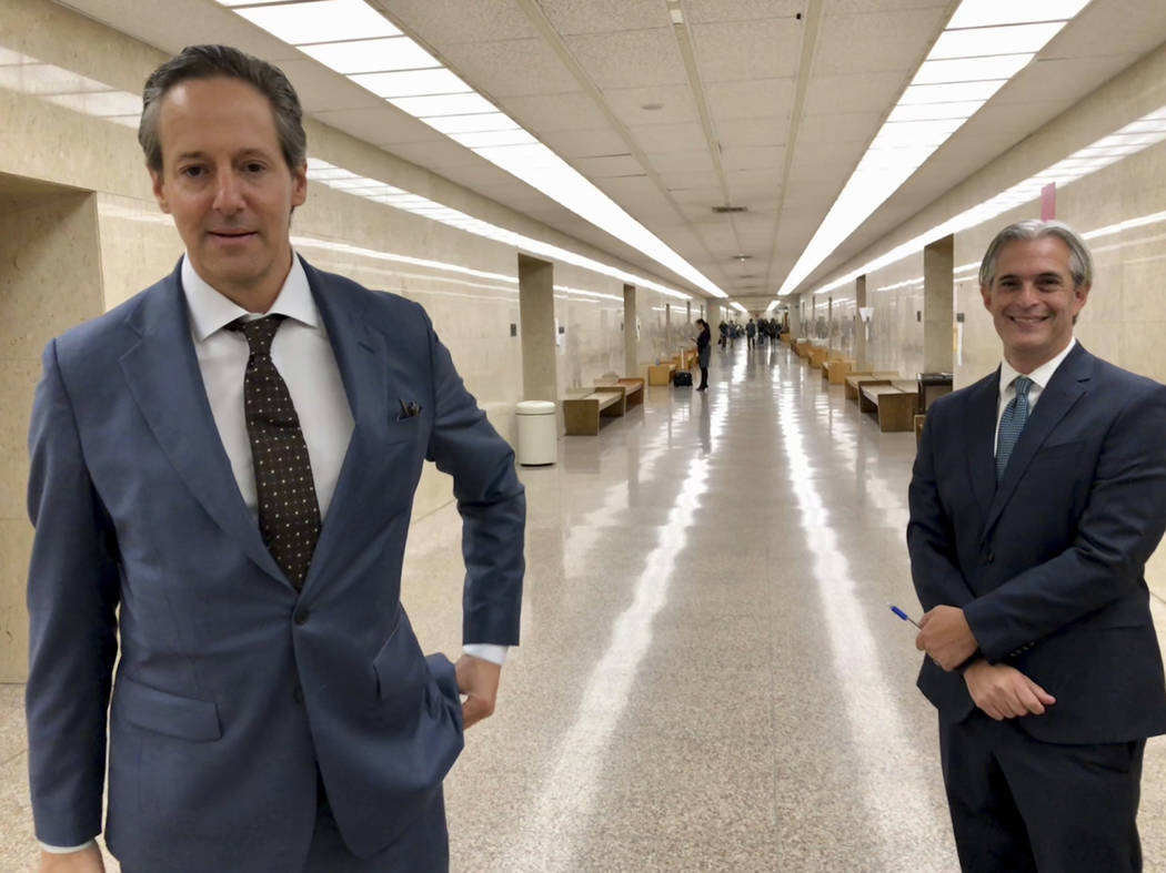 Jason Frank, right, and his attorney Eric George leave a Los Angeles County Superior Court on Monday, Oct. 22, 2108. On Monday a California judge has ordered Stormy Daniels' lawyer Michael Avenatt ...