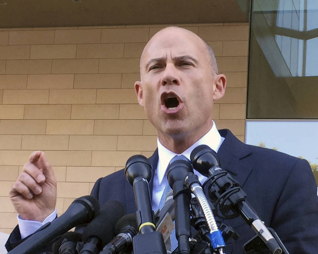 Michael Avenatti, attorney for porn actress Stormy Daniels, talks to reporters after a federal court hearing in Los Angeles, Sept. 24, 2018. (AP Photo/Amanda Lee Myers, File)