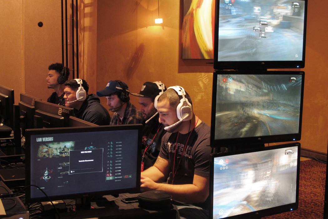 Video game players compete against one another in an esports tournament at Caesars casino in Atlantic City, N.J. on March 31, 2017. (AP Photo/Wayne Parry, File)