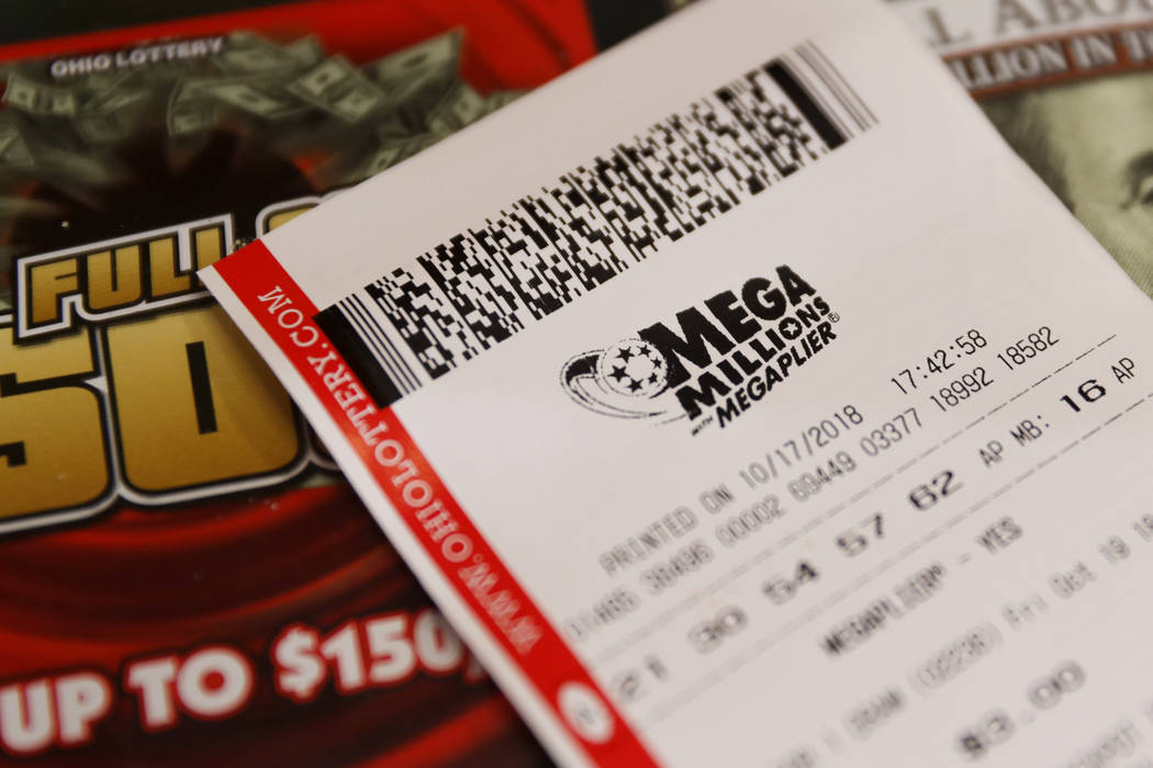 A Mega Millions lottery ticket rests on the shop counter at the Street Corner Market, Wednesday, Oct. 17, 2018, in Cincinnati. The estimated jackpot for Friday's drawing would be the second-larges ...