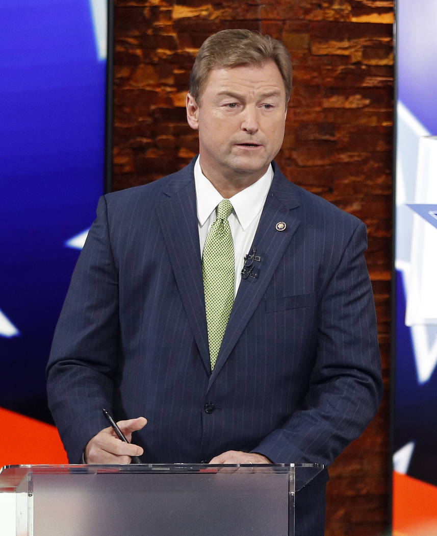 Sen. Dean Heller, R-Nev., prepares before a U.S. Senate debate with Rep. Jacky Rosen, D-Nev., Friday, Oct. 19, 2018, in Las Vegas. (AP Photo/John Locher, Pool)