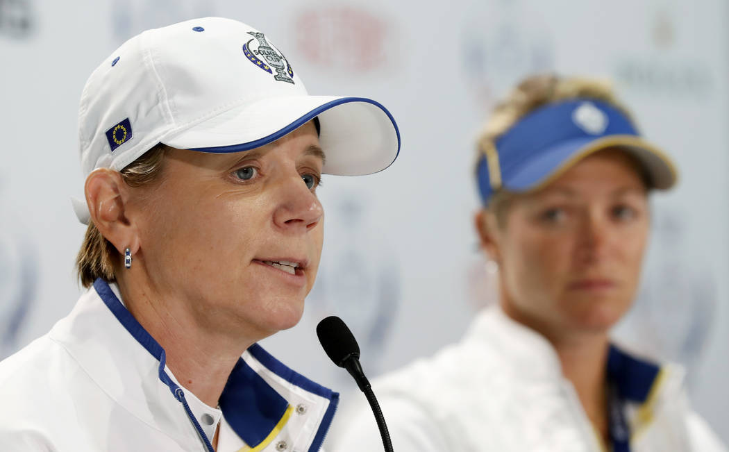 Europe captain Annika Sorenstam, of Sweden, speaks during a news conference for the Solheim Cup golf tournament as Europe's Suzann Pettersen, of Norway, right, looks on, Wednesday, Aug. 16, 2017, ...