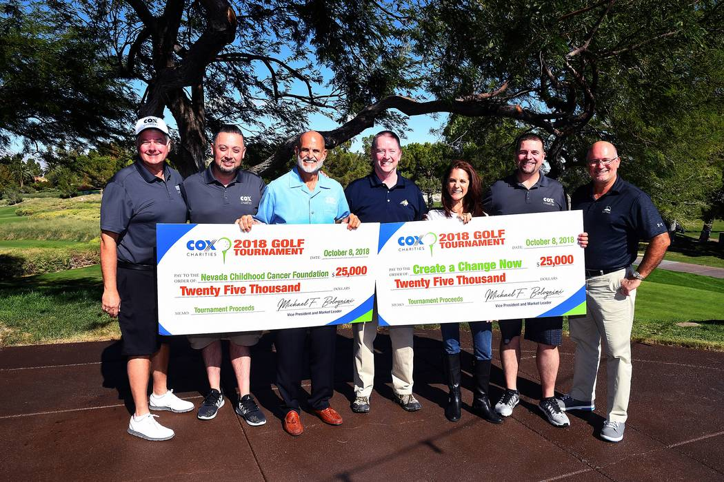 Nevada Childhood Cancer Foundation and Create a Change Now each received $25,000 from Cox Charities at the annual Cox Charities Golf Tournament. Pictured, from left, are Michael Bolognini, Cox mar ...