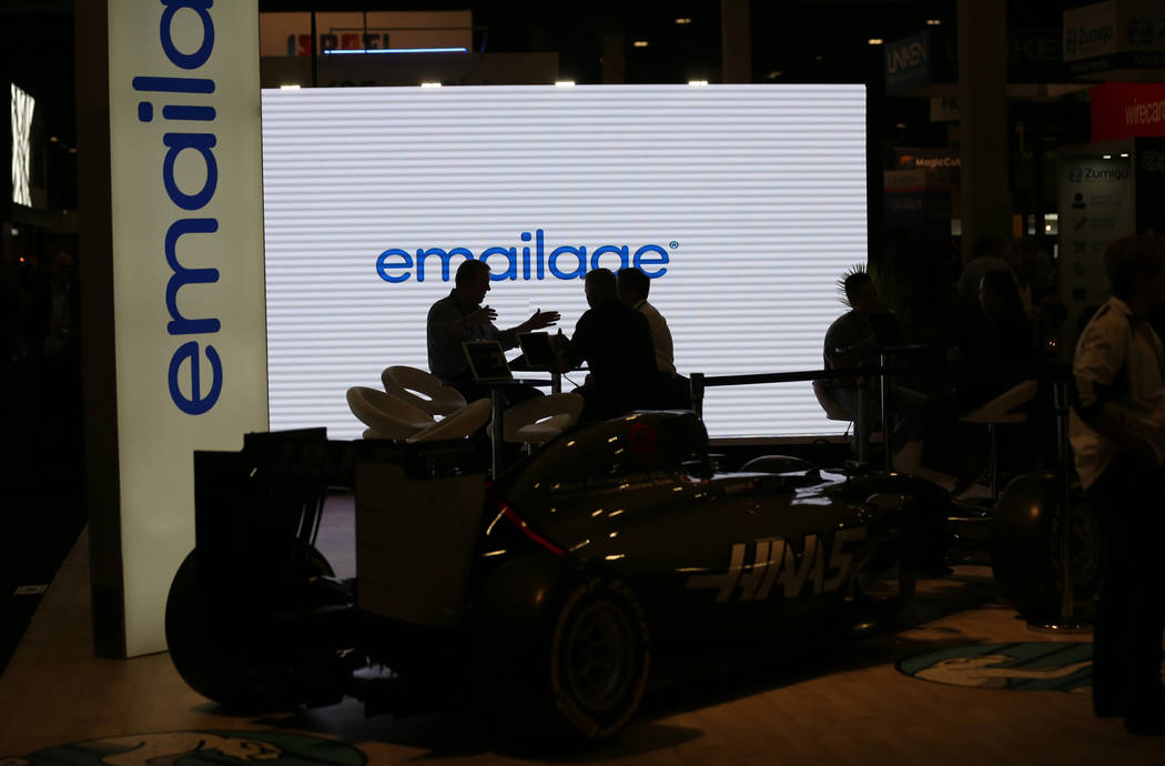 Conventioneers mingle at the Emailage booth at the Money 20/20 show at the Venetian in Las Vegas Tuesday, Oct. 23, 2018. K.M. Cannon Las Vegas Review-Journal @KMCannonPhoto