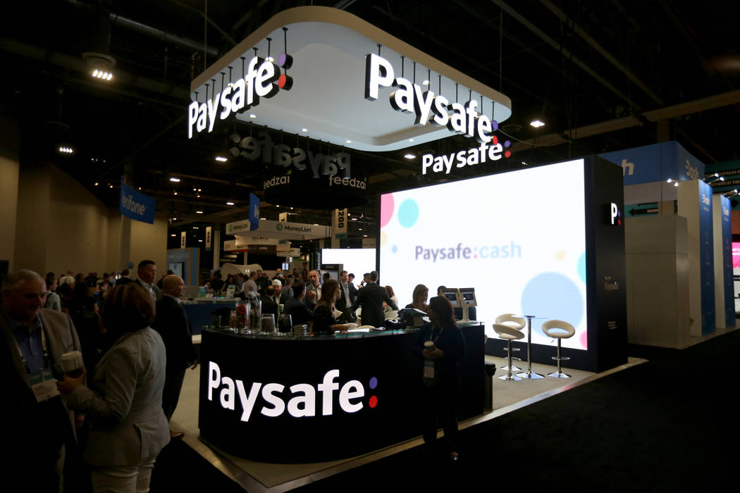 Conventioneers mingle at the Paysafe booth at the Money 20/20 show at the Venetian in Las Vegas Tuesday, Oct. 23, 2018. K.M. Cannon Las Vegas Review-Journal @KMCannonPhoto