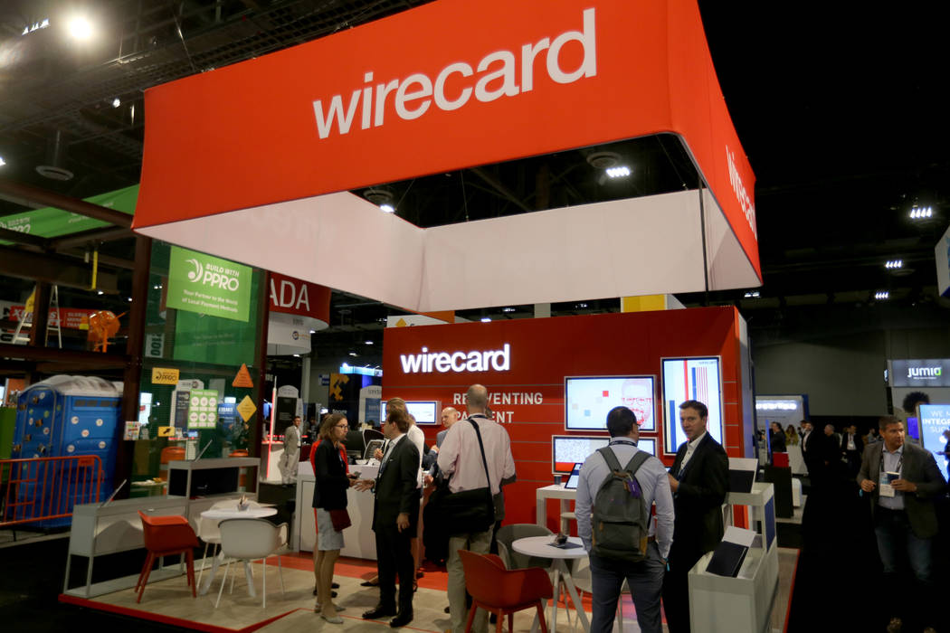 Conventioneers mingle at the Wirecard booth at the Money 20/20 show at the Venetian in Las Vegas Tuesday, Oct. 23, 2018. K.M. Cannon Las Vegas Review-Journal @KMCannonPhoto