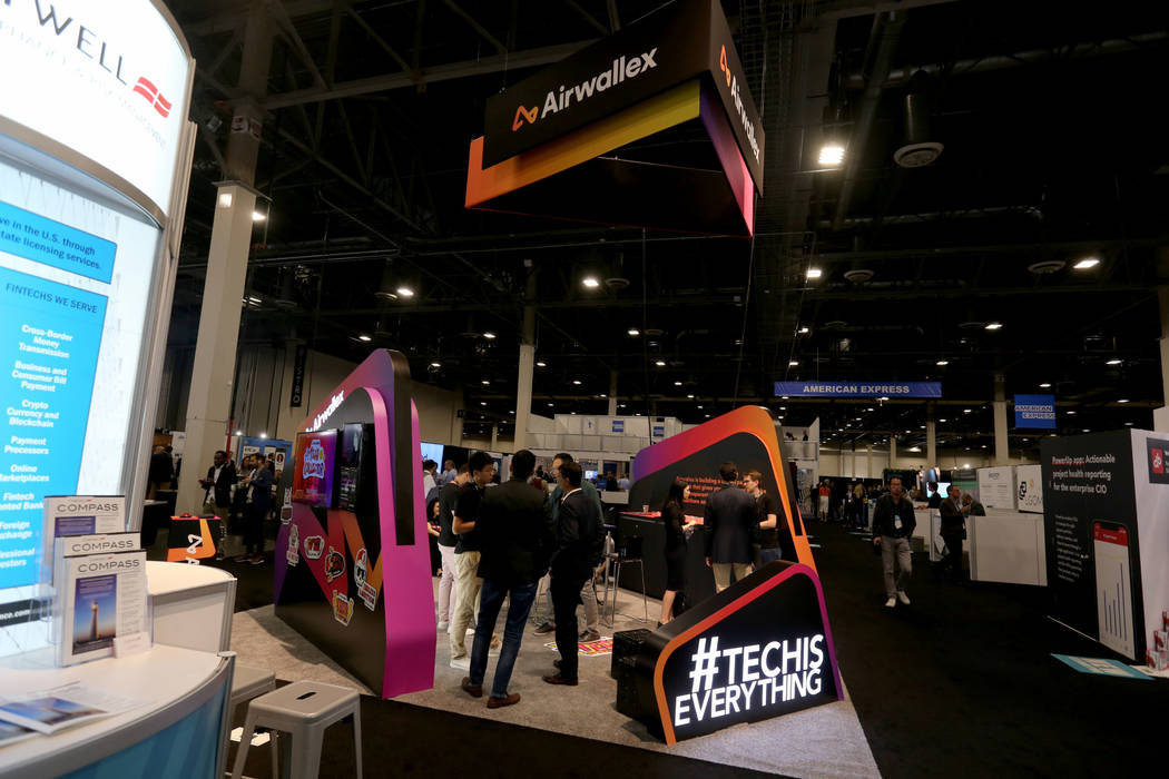 Conventioneers mingle at the Airwallex booth at the Money 20/20 show at the Venetian in Las Vegas Tuesday, Oct. 23, 2018. K.M. Cannon Las Vegas Review-Journal @KMCannonPhoto