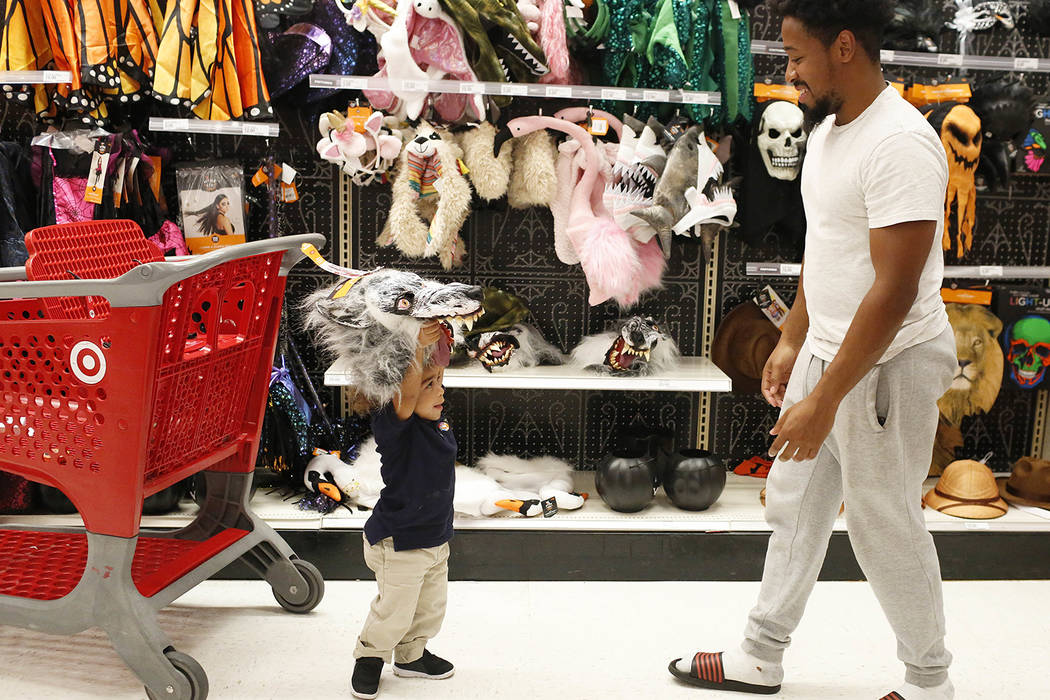 Customers shop at a Target department store on Wednesday, Oct. 3, 2018, in Pembroke Pines, Fla. (AP Photo/Brynn Anderson)