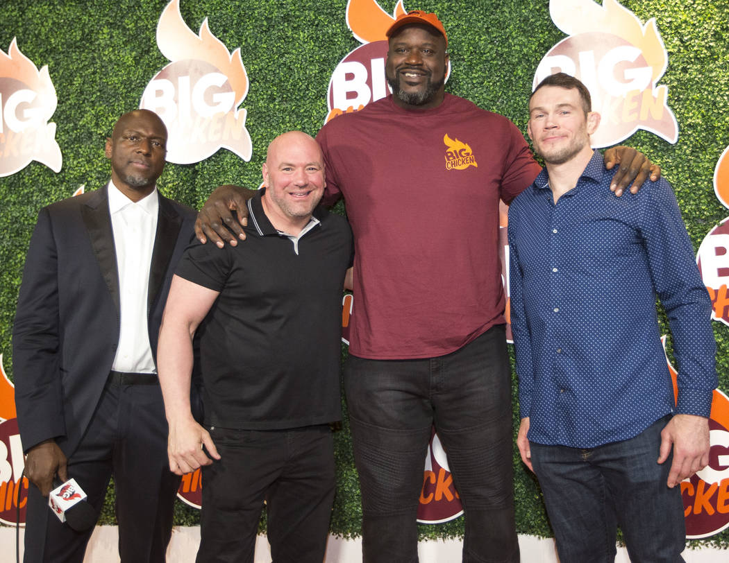 Retired NBA player Shaquille O'Neal poses with UFC President Dana White, second left, and retired mixed martial artist Forrest Griffin, right, as red carpet host Anthony Hall looks on during the g ...