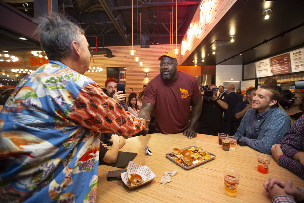 Retired NBA player Shaquille O'Neal, center, greets guests during the grand opening celebration of Big Chicken, Shaq's new fast-casual chicken restaurant located at 4480 Paradise Road in Las Vegas ...