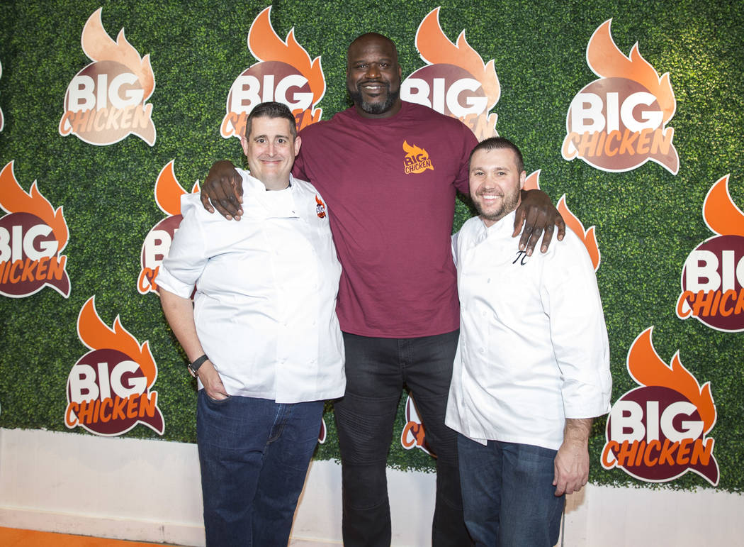 Retired NBA player Shaquille O'Neal poses with business partner Matthew Silverman, left, and vice president of culinary operations Matthew Piekarski during the grand opening celebration of Big Chi ...