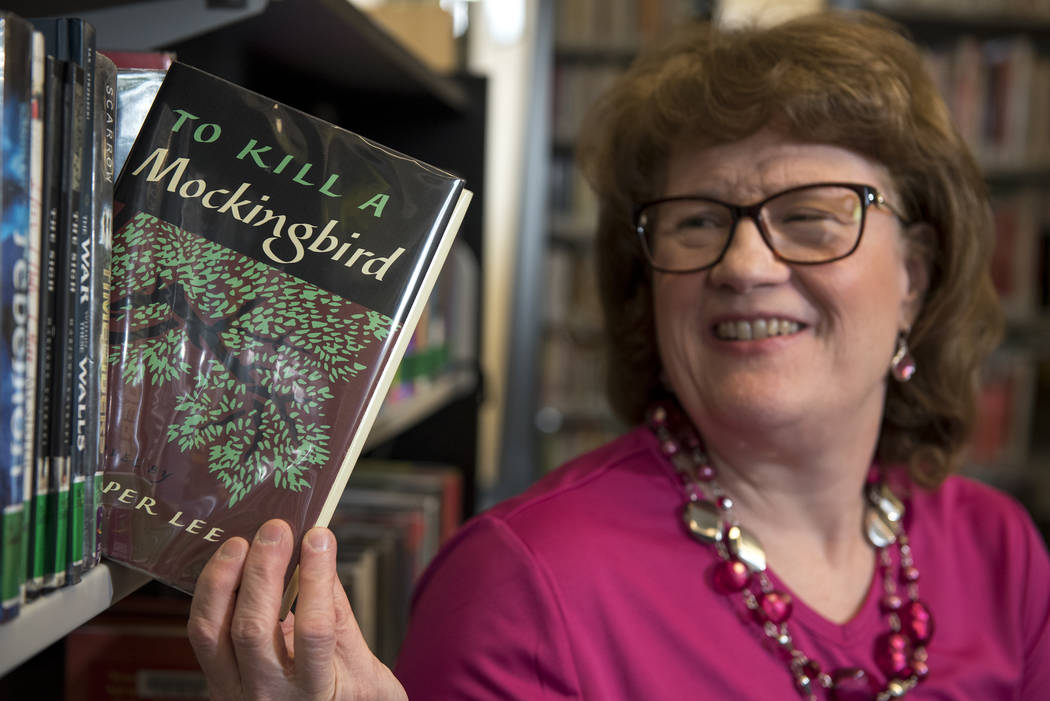 "Librarian Debbie Tinsler poses with ""To Kill a Mockingbird"" by Harper Lee at the Rainbow Library in Las Vegas on Friday, June 26, 2015. (Martin S. Fuentes/Las Vegas Review-Journal)"