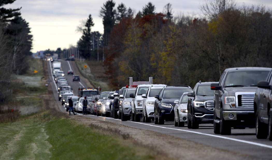 Volunteers line up along Highway 25 just north of Barron, Wis., Oct. 23, 2018, to assist in the search for Jayme Closs, a missing teenage Wisconsin girl, whose parents were killed in the family's ...