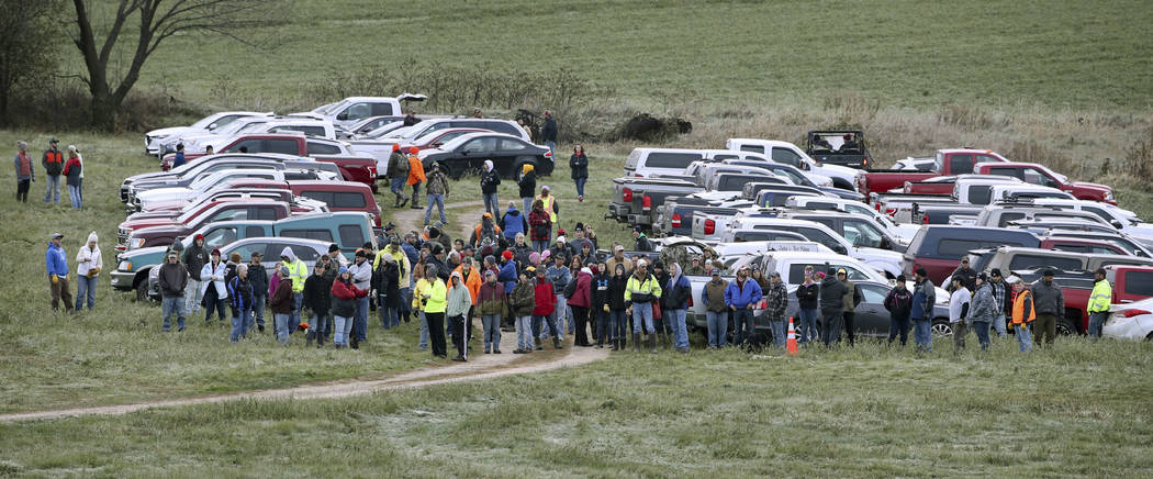 Hundreds of volunteers gather Tuesday, Oct. 23, 2018, in Barron, Wis., to assist in the search for Jayme Closs, a missing teenage Wisconsin girl, whose parents were killed in the family's home. Ja ...