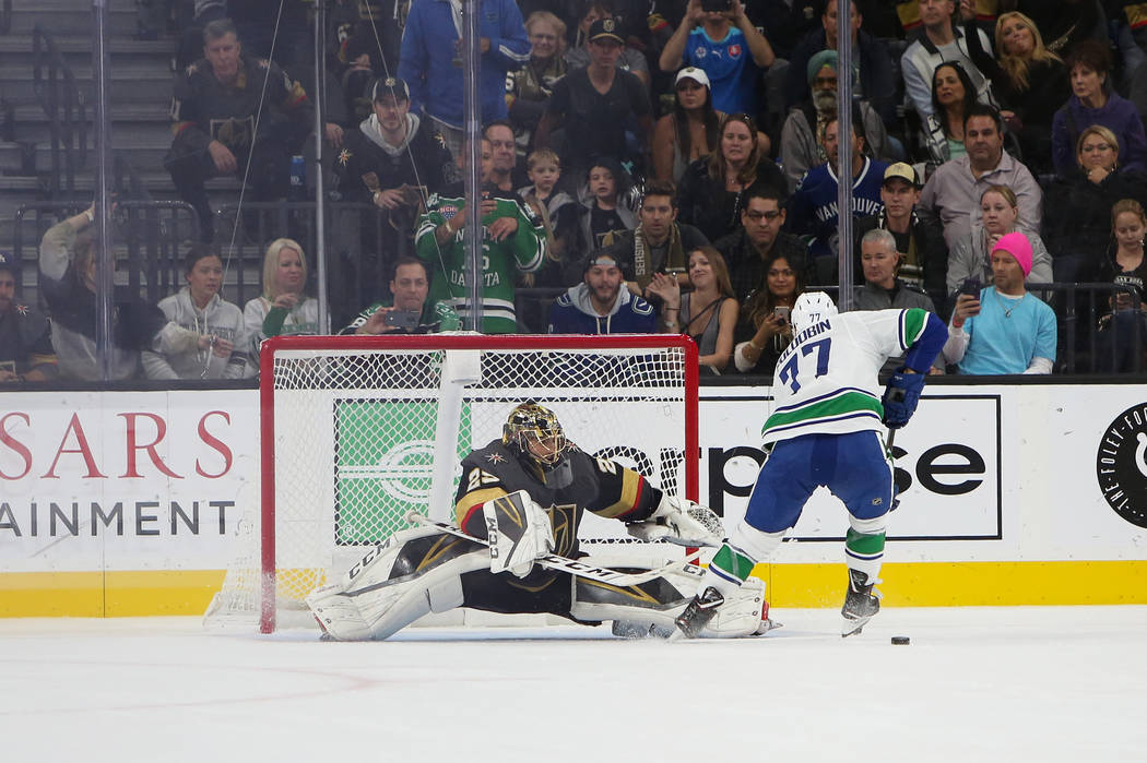 Golden Knights goaltender Marc-Andre Fleury (29) blocks a shot from Vancouver Canucks right wing Nikolay Goldobin (77) during a shootout in overtime of an NHL hockey game at T-Mobile Arena in Las ...