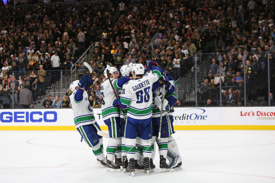 The Vancouver Canucks celebrate their win over the Golden Knights during an NHL hockey game at T-Mobile Arena in Las Vegas, Wednesday, Oct. 24, 2018. Caroline Brehman/Las Vegas Review-Journal