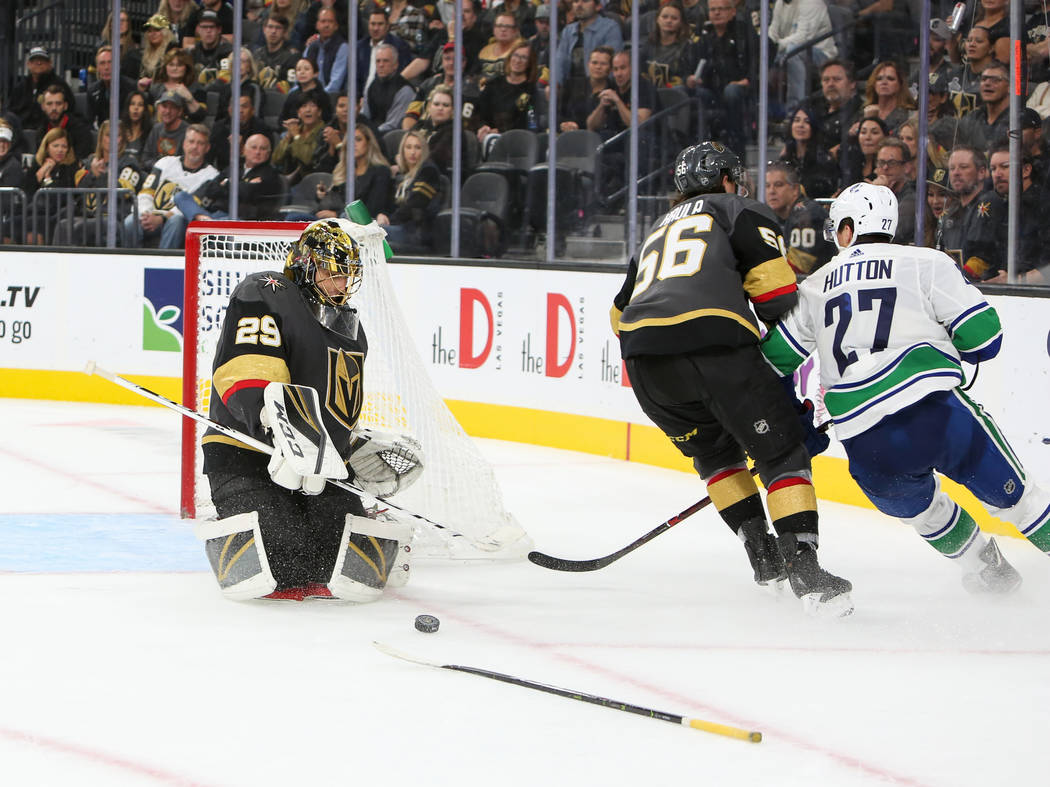 Golden Knights goaltender Marc-Andre Fleury (29) blocks a shot from the Vancouver Canucks during an overtime period of an NHL hockey game at T-Mobile Arena in Las Vegas, Wednesday, Oct. 24, 2018. ...