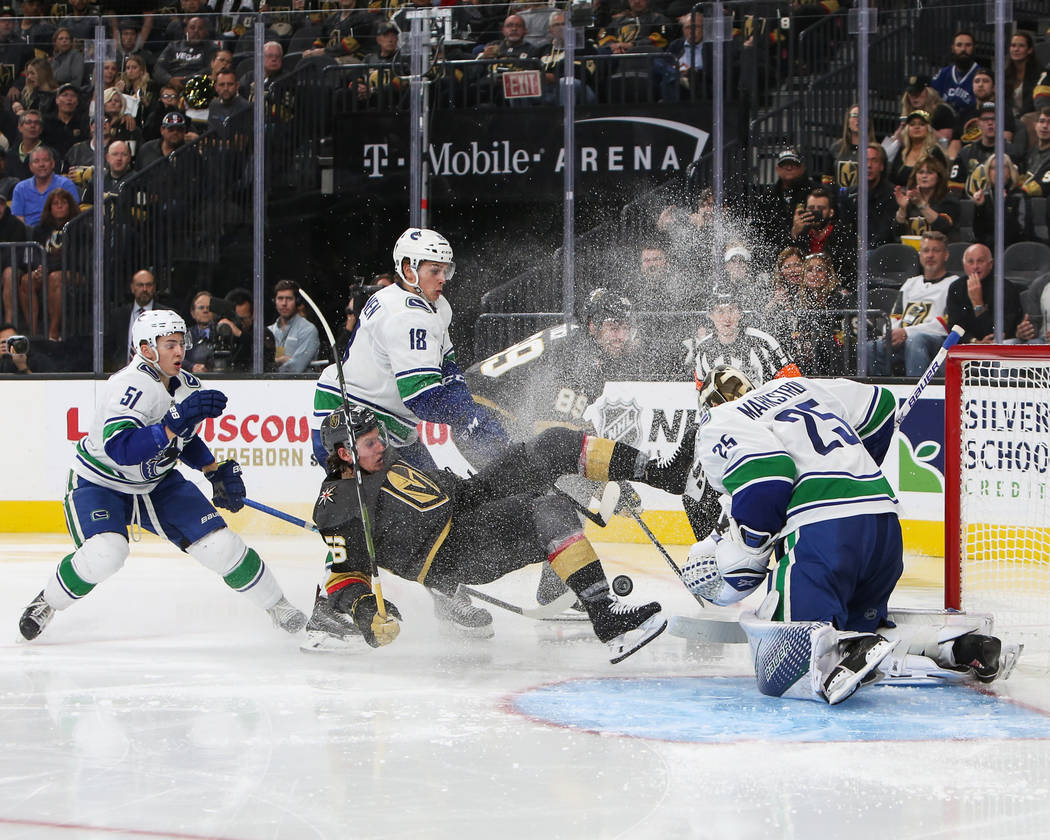 Vancouver Canucks goaltender Jacob Markstrom (25) blocks a shot from the Golden Knights during the third period of an NHL hockey game at T-Mobile Arena in Las Vegas, Wednesday, Oct. 24, 2018. Caro ...