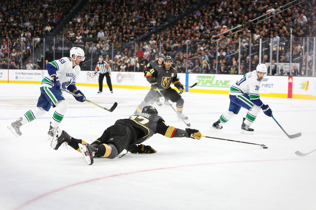 Golden Knights defenseman Shea Theodore (27) reaches for the puck during the third period of an NHL hockey game at T-Mobile Arena in Las Vegas, Wednesday, Oct. 24, 2018. Caroline Brehman/Las Vegas ...