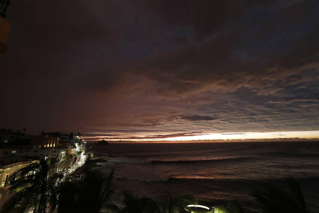 The sun sets, as Hurricane Willa makes landfall, in Mazatlan, Mexico, Tuesday, Oct. 23, 2018. Emergency officials said they evacuated more than 4,250 people in coastal towns and set up 58 shelters ...