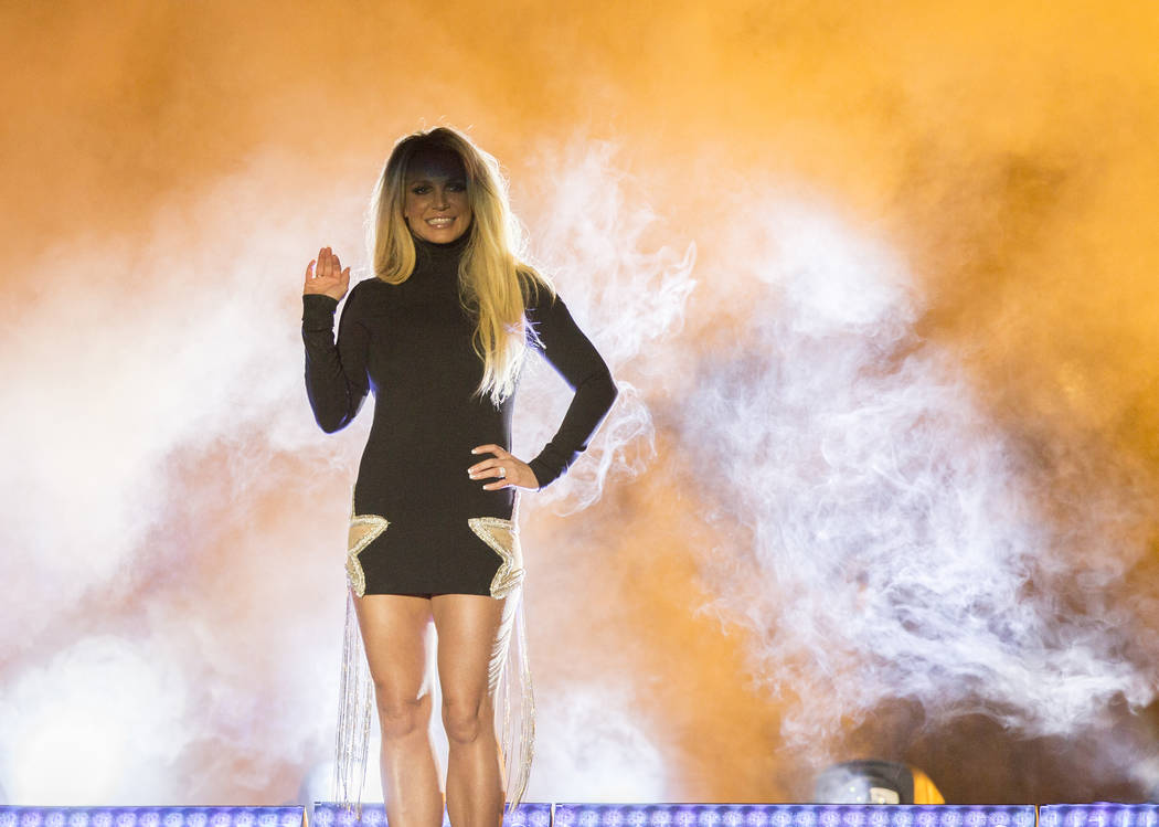 Britney Spears appears on stage during an event to announce her new residency at The Park Theater at Park MGM on Thursday, Oct. 18, 2018, outside T-Mobile Arena, in Las Vegas. (Benjamin Hager/Las ...