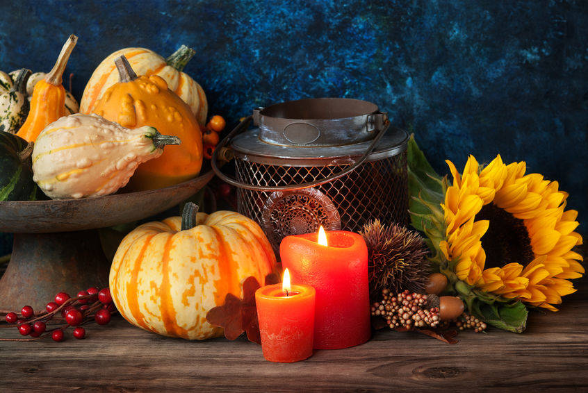 The combination of candles, sunflowers and pumpkins are perfect for autumn decor. (Ganna Didora)
