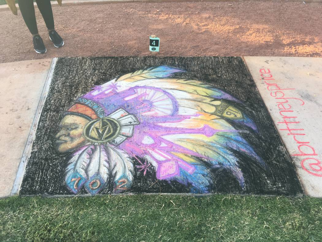 Local artist Brittany Price walked away with $500 in the People's Choice Award for her chalk drawing of an American Indian headdress with a variety of Las Vegas themes interwoven in the feathers ...