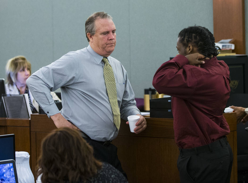 Defense attorney Bret Whipple, left, talks with Norman Smith, accused of shooting and killing Tinesha Antovia Adams, who was pregnant, at the Regional Justice Center in Las Vegas on Wednesday, Oct ...