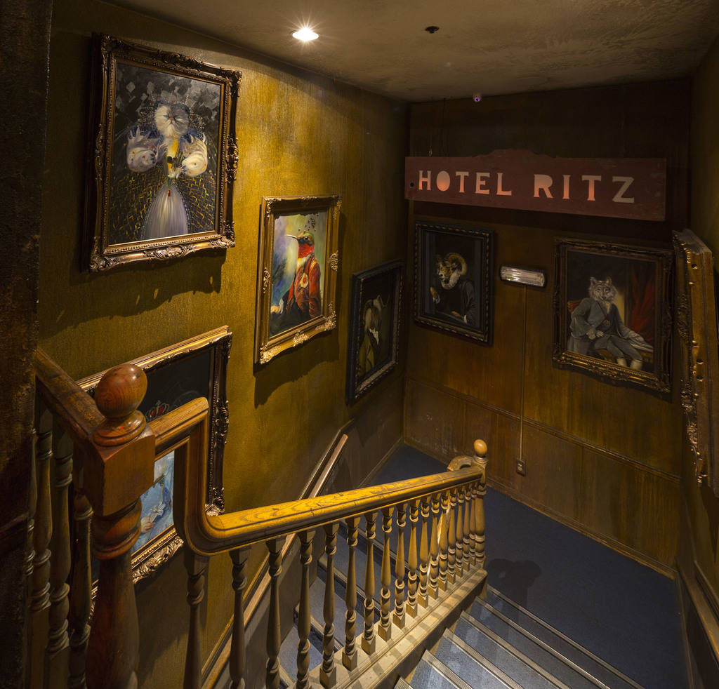 A collection of artwork hangs in a stairwell at Zak Bagans' The Haunted Museum located at 600 E. Charleston Blvd. in downtown Las Vegas on Monday, Oct. 22, 2018. Richard Brian Las Vegas Review-Jou ...
