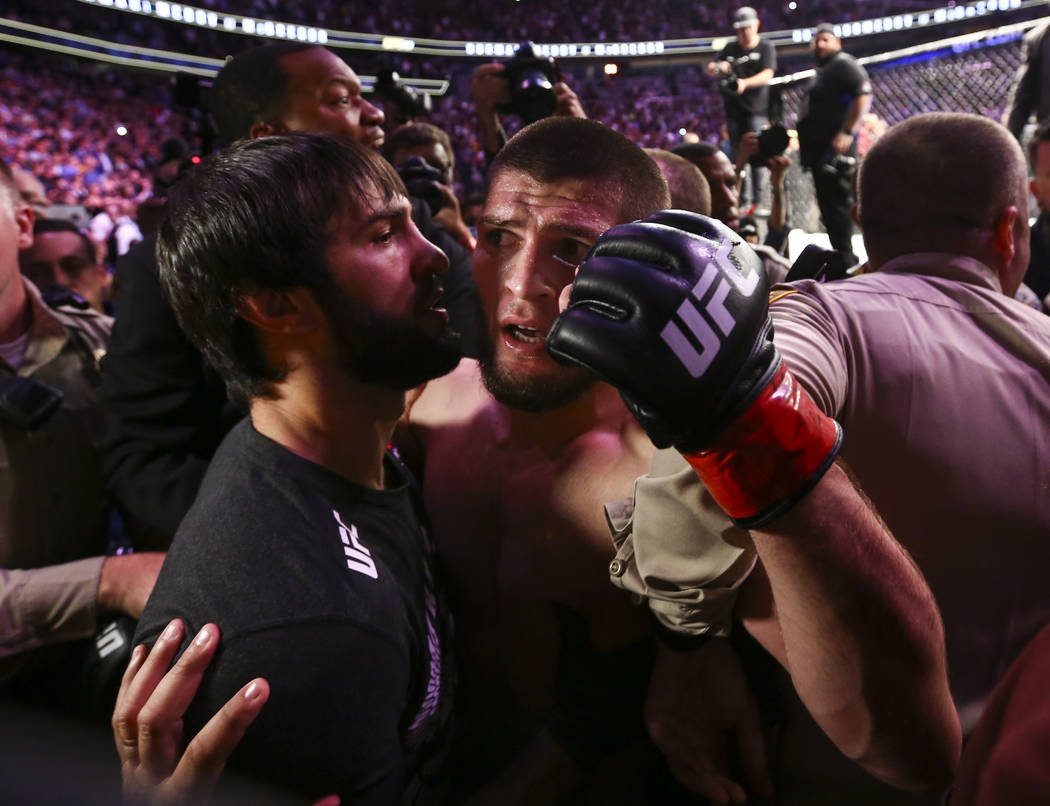 Khabib Nurmagomedov is restrained outside of the octagon after he defeated Conor McGregor at UFC 229 at T-Mobile Arena in Las Vegas on Saturday, Oct. 6, 2018. Chase Stevens Las Vegas Review-Journa ...