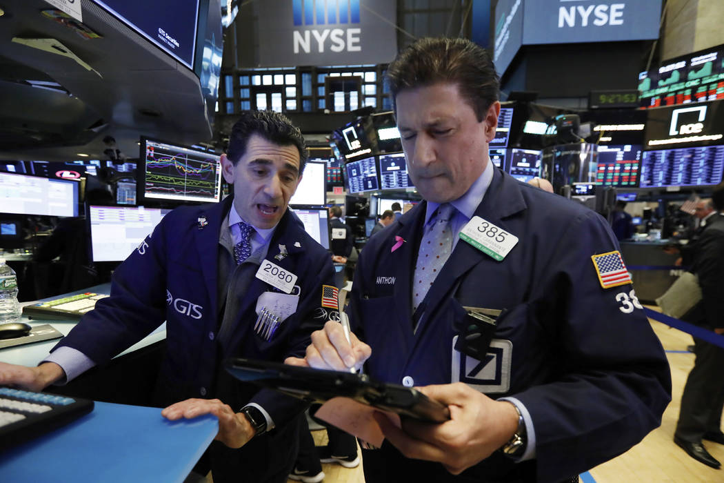 Specialist Peter Mazza, left, and trader Anthony Carannante work on the floor of the New York Stock Exchange, Wednesday, Oct. 24, 2018. Stocks are off to a mixed start on Wall Street as gains for ...