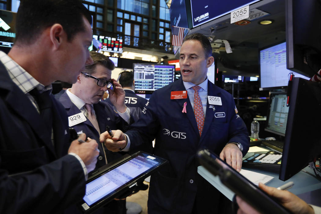 Specialist Jason Hardzewicz, right, works on the floor of the New York Stock Exchange, Wednesday, Oct. 24, 2018. Stocks are off to a mixed start on Wall Street as gains for Boeing and other indust ...