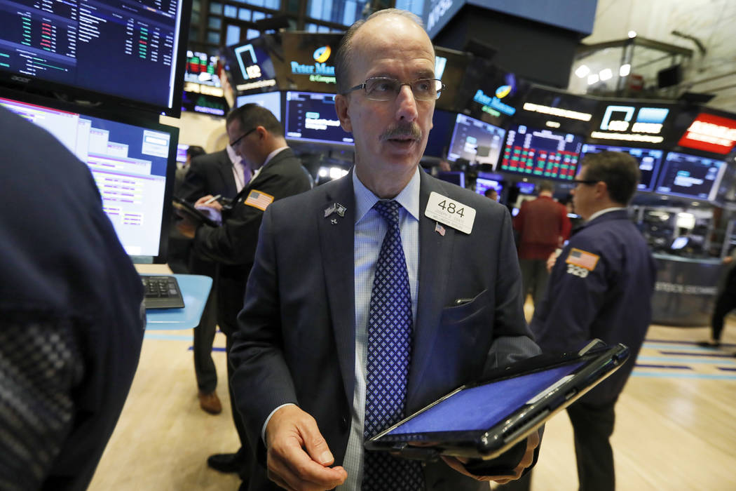 Trader Joseph Dente works on the floor of the New York Stock Exchange, Wednesday, Oct. 24, 2018. Stocks are off to a mixed start on Wall Street as gains for Boeing and other industrial companies a ...