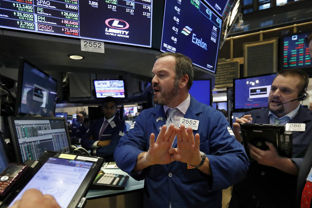 Specialist Charles Boeddinghaus, center, and trader Michael Milano work on the floor of the New York Stock Exchange, Wednesday, Oct. 24, 2018. Stocks are off to a mixed start on Wall Street as gai ...