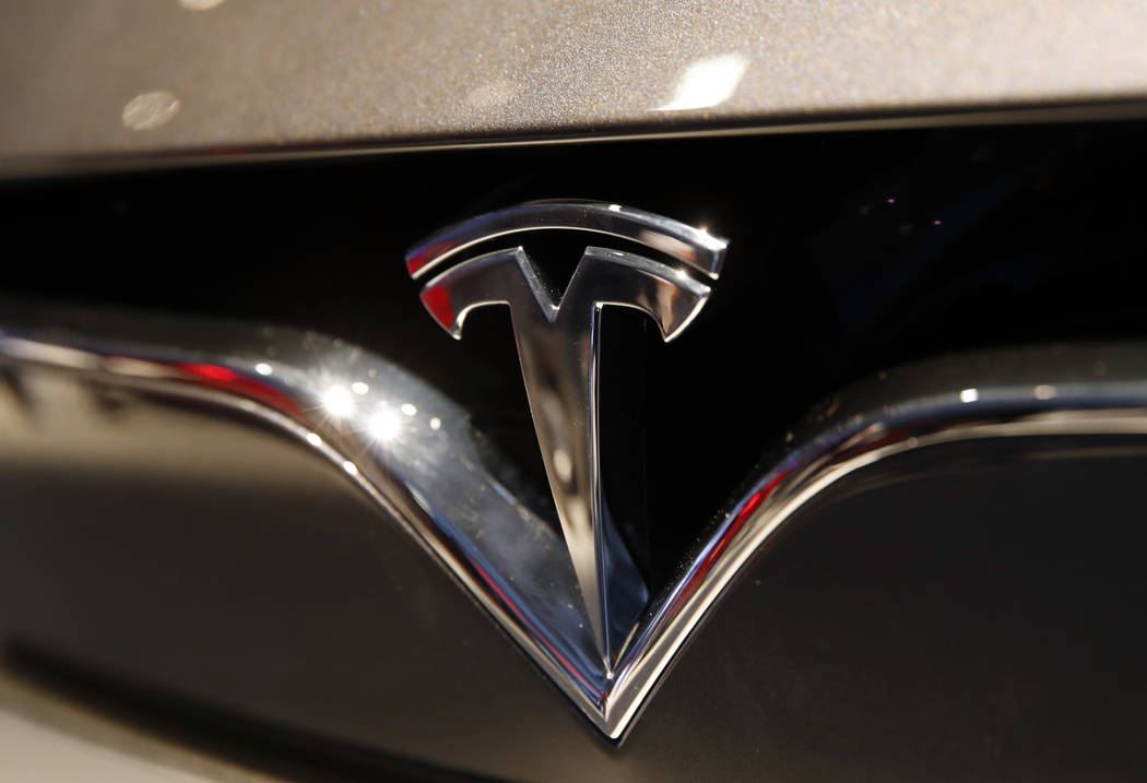 Tesla emblem at the Auto show in Paris on Oct. 3, 2018. Shares of Tesla Inc. soared Tuesday, Oct. 23, a day ahead of the company's third-quarter earnings release. (AP Photo/Christophe Ena, File)