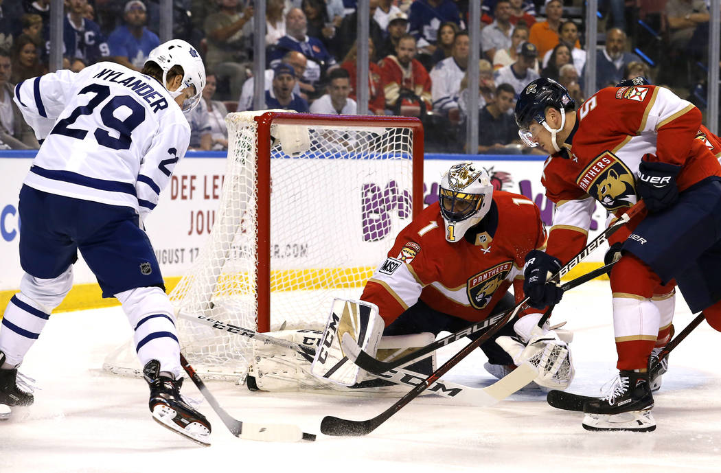 Toronto Maple Leafs center William Nylander (29) can't score as Florida Panthers goaltender Roberto Luongo (1) and defenseman MacKenzie Weegar, right, defend in the first period of an NHL hockey g ...