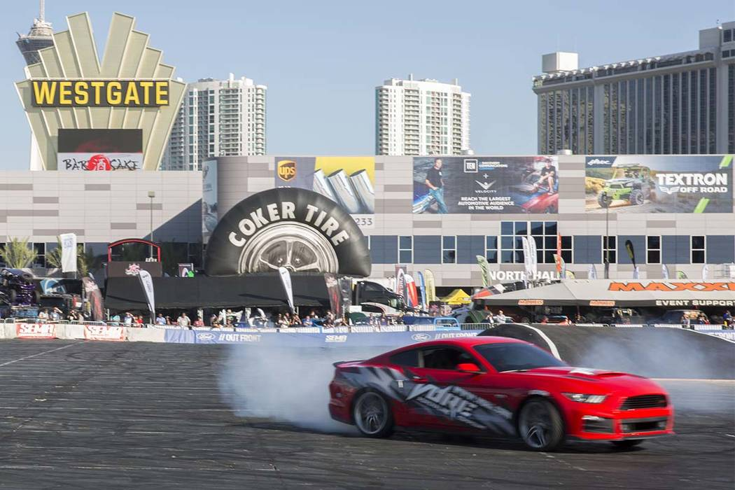 Enhanced Ford cars demonstrate their drifting capabilities on a makeshift racetrack at the SEMA Show. on Oct. 31, 2017 in Las Vegas. Todd Prince Las Vegas Review-Journal