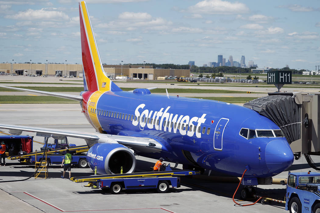 Ramp workers prepare a Southwest Airlines Boeing 737 for departure to Denver from Minneapolis International Airport in Minneapolis, on July 17, 2018. (AP Photo/David Zalubowski)