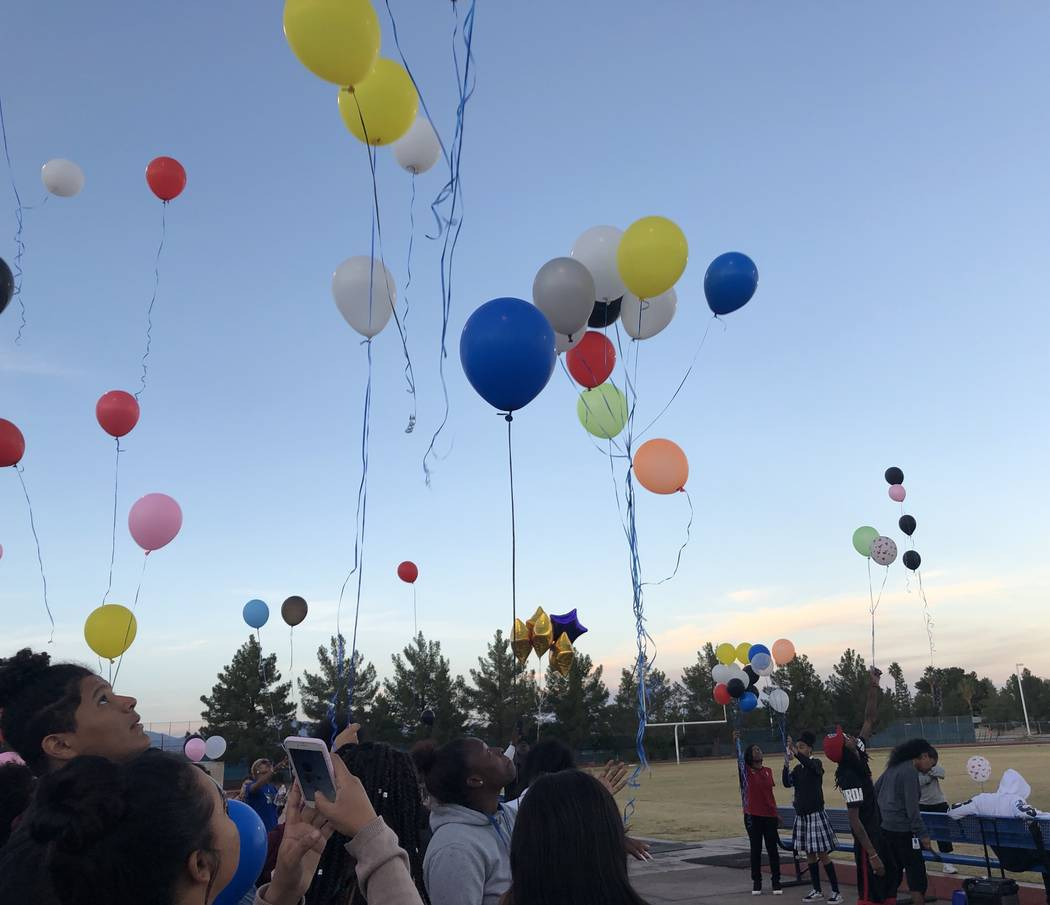 A group of students, family and friends release balloons into the sky during a vigil honoring Susan Nash at Desert Pines High School on Oct. 24, 2018. Nash, a special education teacher's aide at t ...
