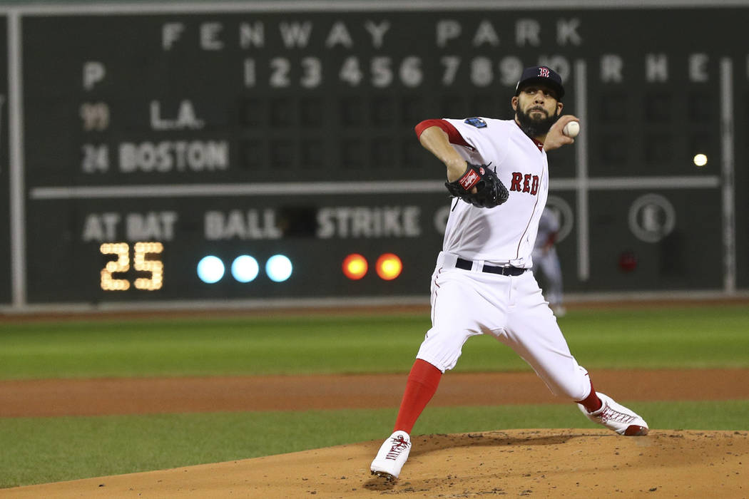 Boston Red Sox starting pitcher David Price throws during the first inning of Game 2 of the World Series baseball game against the Los Angeles Dodgers Wednesday, Oct. 24, 2018, in Boston. (AP Phot ...