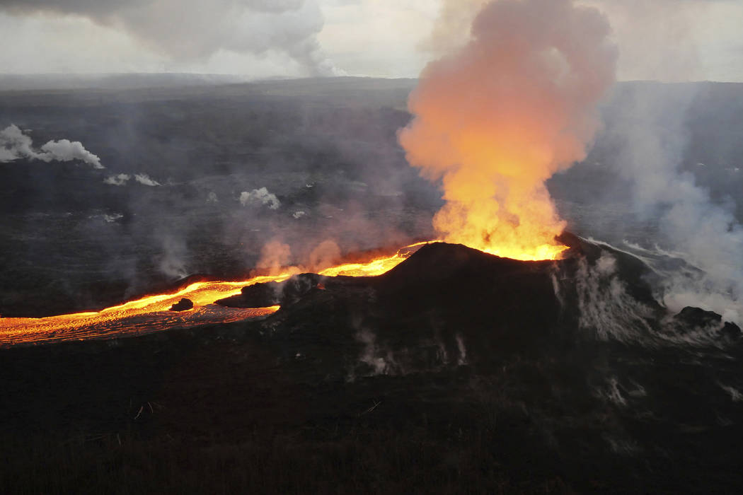 Lava from Kilauea volcano erupts in the Leilani Estates neighborhood near Pahoa, Hawaii on Saturday, July 14, 2018. On Thursday, Oct. 25, 2018, government scientists updated 18 U.S. volcanoes as a ...
