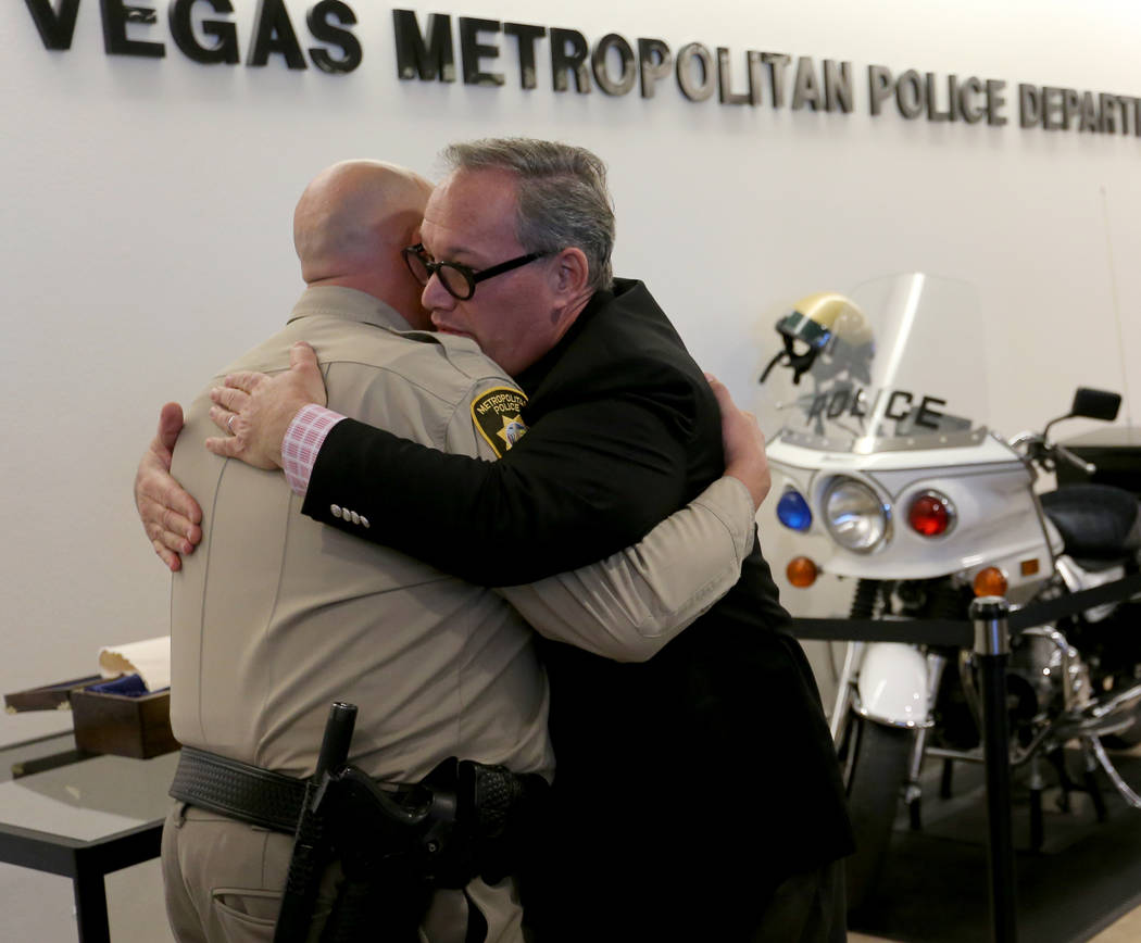 """Las Vegas police Lt. Harry Fagel and Nevada School of the Arts President and CEO Patrick Duffy at the unveiling of """"The Route"""" poem scroll at Metropolitan Police Department headquarters in Las Veg ..."""